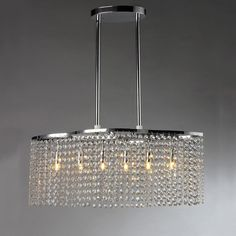 Add some opulence to your home with the six-light Tee Crystal Chandelier. This dynamic lighting element highlights a glinting chrome metal finish, and generous rows of cascading crystals that catch the light.