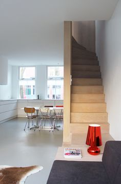 Unknown Architects renovate house with combined staircase and sofa