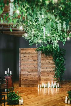 Ceremony backdrop decorated with fern and white candles in hurricanes line the floor ~ we ❤ this! moncheribridals.com