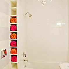 Even the smallest nooks and crannies can be put to good use as this reader did by creating a ceiling-height towel rack between wall and tub.   2013 Reader Remodel Contest