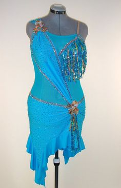Luxury blue crepe lycra accented with blue sequence fringe