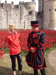"Hannah Kokoschka after planting poppies at the Tower of London August 2014 with the head beefeater (her new friend!) as part of Paul Cummins amazing installation ""Blood Swept Land and Seas of Red."""