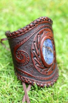 Leather cuff with stone inlay.  Leather has been hand cut, carved, dyed and stitched to give this cuff its stunning look