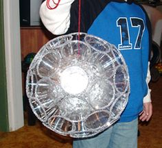 New Years Ball!    kids will love making this.  NO electricity envolved.  Styrofoam ball wrapped in tinfoil.  Plastic cups with glitter edges are glued to the ball.
