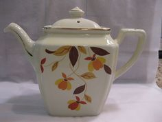 my grandmother had this pattern for everyday ....Jewel Tea, Autumn Leaf pattern, made by Hall China Company