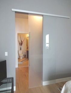 There are basically two types of barn door hardware. The first is a rustic, flat track sliding door system The second is a more modern roller and track style Sliding Glass Barn Doors, Sliding Wall, Sliding Door Design, Interior Sliding Barn Doors, Sliding Barn Door Hardware, Interior Glass Doors, Door Dividers, Bathroom Doors, Master Bathroom