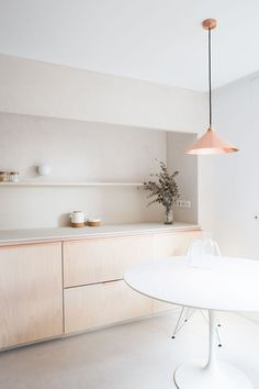 Kitchen with copper light fittings