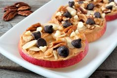 Simple and delicious sliced apples topped with peanut butter, chocolate and white chips and nuts.