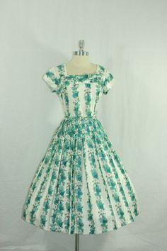 1950s Spring Dress -  Vintage - Polished Cotton Full Skirt Novelty Floral Print Swing Dress. $180.00, via Etsy.
