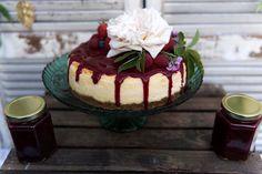 Vanilla cheesecake with berry compote, raspberries & pink roses from the Handmade Cake Company. Weddings & birthdays. Photographer: Darryl Renyk