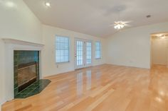 Spacious living room with hardwood flooring and fireplace. For current pricing or to schedule a showing please call 904-280-3000 www.christineleetem.com