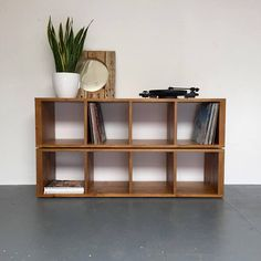This solid wood double height shelving console is ideal for storing vinyl records, shoes, books or anything else. If used for vinyl records it will accommodate between 600 and 800 vinyl records depending on the size. It is hand made from high quality softwood timber and is fitted with