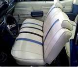 Most cars had front bench seats.  Guys would drive with one hand on the wheel and the other around his girl's shoulder.