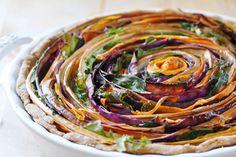 Vegan Spiral Vegetable Tart- spelt crust, savory pie. Mandolin slicer, eggplant, carrots, pumpkin puree, greens, cabbage and balsamic vinegar.