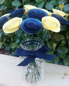 Check out this item in my Etsy shop https://www.etsy.com/listing/269625869/yellow-and-navy-paper-flowers-wedding