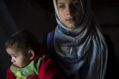 Raeda, and her baby brother are among 11 relatives sharing a tent here, after an explosion near their home in Aleppo, Syria, partly blinded her. Six Month, Creative Poster Design, Refugee Crisis, Holocaust Memorial, Syrian Refugees, People Around The World, Ny Times, Human Rights, War