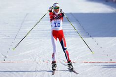 Kristin Stoermer Steira of Norway celebrates crossing the finish line in third place to win the bronze medal in the Women's 30 km Mass Start Free (c) Getty Images Cross Country Skiing, Winter Olympics, Finish Line, Norway, Third, Bronze, Celebrities, Free, Image