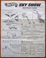 Page from an illustrated instruction manual for a Hot Wheels toy product.