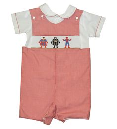 It's a bird!...It's a plane!...It's the cutest outfit for boys you've seen in a long time!  This red, micro-check shortall is smocked with fun, colorful pictures of three superheroes who bear a suspicious resemblance to Batman, Spiderman, and Superman.  It comes with a white, button-up shirt, with a matching red microcheck trim. $49.99