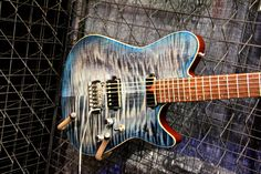 Electric solid body guitar from Lipe Guitars. NAMM Show, Jan 2012.  http://www.vintageandrare.com/builder/Lipe-Guitars-173