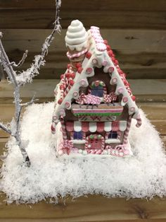 Ginger bread house on snow.