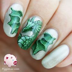 Green dragon nail art by PiggieLuv from Nail Art Gallery