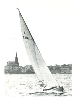 """In the summer of 1953 my father bought a sailingboat, of the typ called """"Folkbåt"""". He christened it Gulle. It carried the number F S 414. This is the only photo I have of it. In the background the church of Lysekil."""