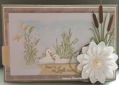 Handmade card by DT member Neline with Creatables Tiny's Cattails (LR0409), Tiny's Swan (LR0408), Petra's Water Lily (LR0406), Punch Die Butterflies (CR1354) and Pocket Card & Marks (COL1389) from Marianne Design