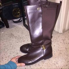 Size 5 in women's chocolate brown MK boots a few stitches missing at the top but this price is a great price. authentic! Michael Kors Shoes