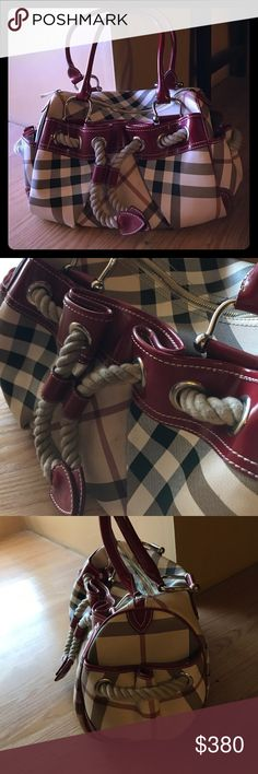 Burberry bag Authentic cute Burberry Purse. I never used this but it has been stored. Ropes are dusty and dirty due to it being stored. There is a minor scratch under but very small. Other than this the bag is in great conditions and needs to be used 😊😊 make your offer :) Burberry Bags Shoulder Bags
