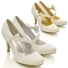 I know these are white rather than silver but they are SO CUTE.  Low heel, strap, all sizes, ok price.  If we go for white bolero/wraps they would look really cute together.