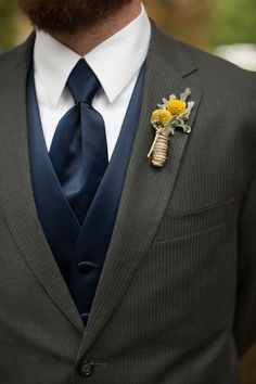 love this groom's dark gray suit with navy vest & tie with yellow billy ball boutonniere  ~  we ❤ this! moncheribridals.com