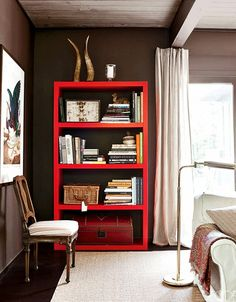 Brown Room With Red Bookcase