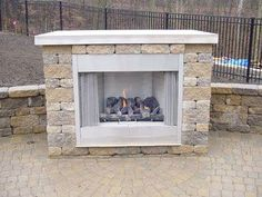 A freestanding gas fireplace built from VERSA-LOK is a nice touch on this raised patio.