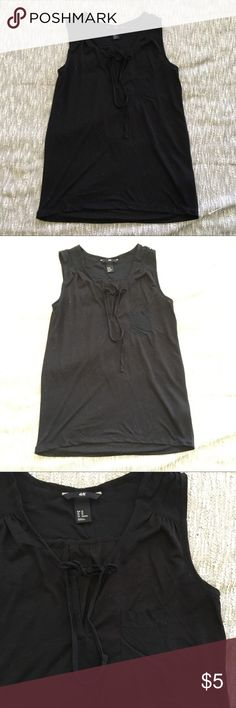 Airy black sleeveless tank with string It's so hard to show black clothing so I put up a super bright photo to show more detail. Thin and airy black sleeveless tank. Little string you can knot or bow in the front (it stays tied well). Sheer above shoulders and top back. Rarely worn. I usually wear small and this fits fine. H&M Tops Blouses