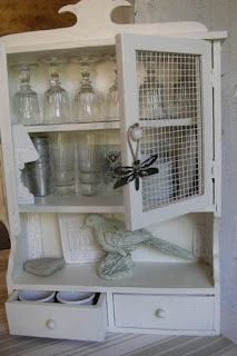 Loving this cabinet with chicken wire mesh
