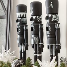 Customize chalkboard-finish nutcrackers for a graphic look this Christmas.
