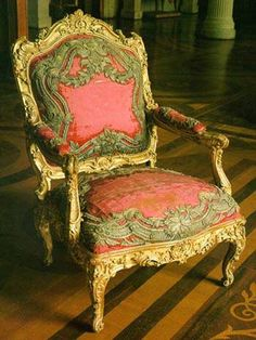 Fauteuil    Attributed to Nicolas Foliot    Mid-18th century    France    Wood, carved and gilt, upholstered in red velvet, silver embroidery. This armchair is part of a suite which was made for Louis XV's daughter, the Princess of Parma, who decorated her Italian palace with furniture imported from Paris.
