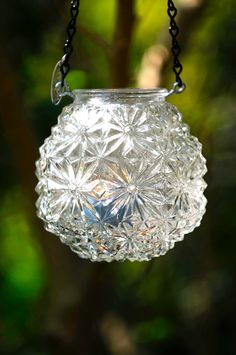 Vintage glass light cover repurposed to candle holder