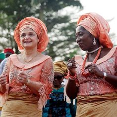 Mothers of the bride and groom at their children's traditional Nigerian wedding.