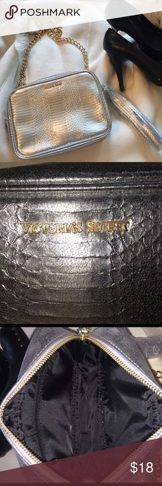 """NWOT Victoria's Secret silver snakeskin with gold NWOT. Still has plastic covers over tassel and on chain. Never carried. Cross body. Measures 9x7x2""""; chain extended measures 24"""" from top of bag. Beautiful!! 🖤🖤🖤 Victoria's Secret Bags Crossbody Bags"""