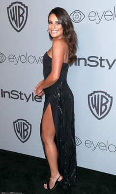 Sexy: Lea looked striking in a figure-hugging black down with a soaring thigh high split...