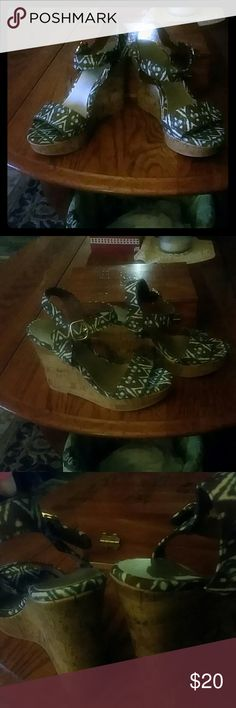 NWOT CORK WEDGES Brand new wedged heels with tribal print colors are brown terquios and white ...Very cute shoes Christian Siriano Shoes Wedges