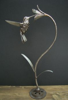 Hummingbird  Made from stainless steel knives forks and scrap nuts and bolts ------------------Artist:shane martin-------------dA Gallery http://shanemartindesigns.deviantart.com/gallery/