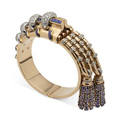 Rose gold bangle set with calibre-cut sapphires, with links decorated in brilliant-cut diamonds set in platinum and hung with two tassels set with brilliant-cut sapphires by Boucheron, Paris 1944-46