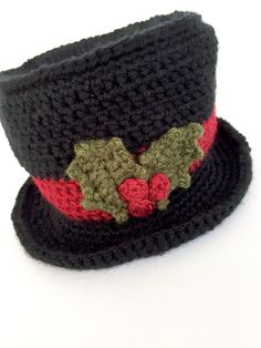 Crochet Beanie Design Snowman Top Hat {FREE PATTERN} - This post includes a free Christmas Holly Crochet Pattern and Photo Tutorial. I had a request for a quick photo tutorial to help with the Holly Leaves used in my Festive Cup Cozy Pattern.I dec. Crochet Snowman, Christmas Crochet Patterns, Crochet Christmas Ornaments, Noel Christmas, Snowman Hat, Snowmen, Xmas, Christmas Crafts, Crochet Top Patterns