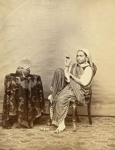 Studio Portrait of an Indian Woman Sitting on a Chair - Indian Pictures, Old Pictures, Old Photos, Vintage India, Jaisalmer, Udaipur, Vintage Photographs, Vintage Images, History Of India