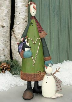 Snowman Holding Penguin with Junior Snowman Figurine : The Official Williraye Studio Store, Folk Art Collectibles and Figurines