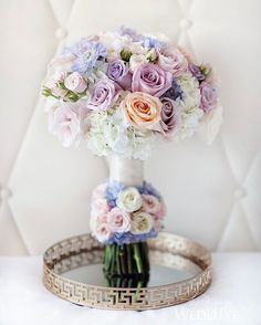A purple-hued #bouquet of scabiosa and roses featuring a halo of blooms encircling the stems? Yes, please!   Photography By: Hong Photography   WedLuxe Magazine   #WedLuxe #Wedding #luxury #weddinginspiration #luxurywedding #floral