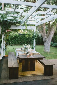 Outdoor pergola. Hardwood outdoor table and bench seats.